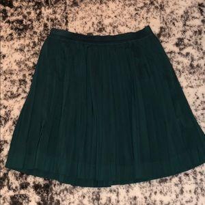 Pleated emerald green skirt